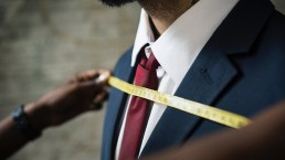 man-being-measured-for-a-custom-suit